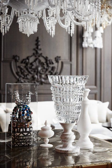 A table set with lead crystal and objets in the baccarat hotels petit salon which · les cristauxdéco