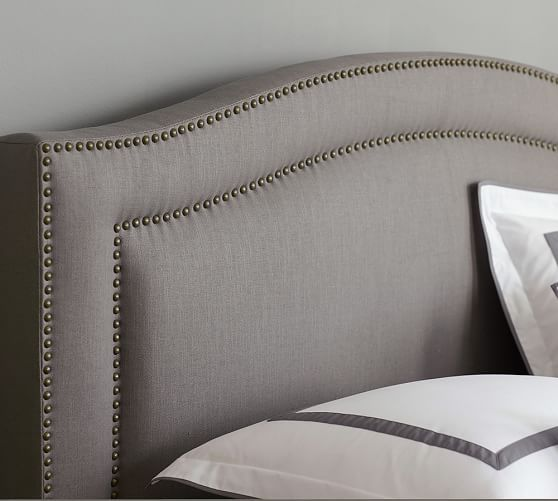 With Its Subtle Curves Angled Headboard And Splayed Legs The