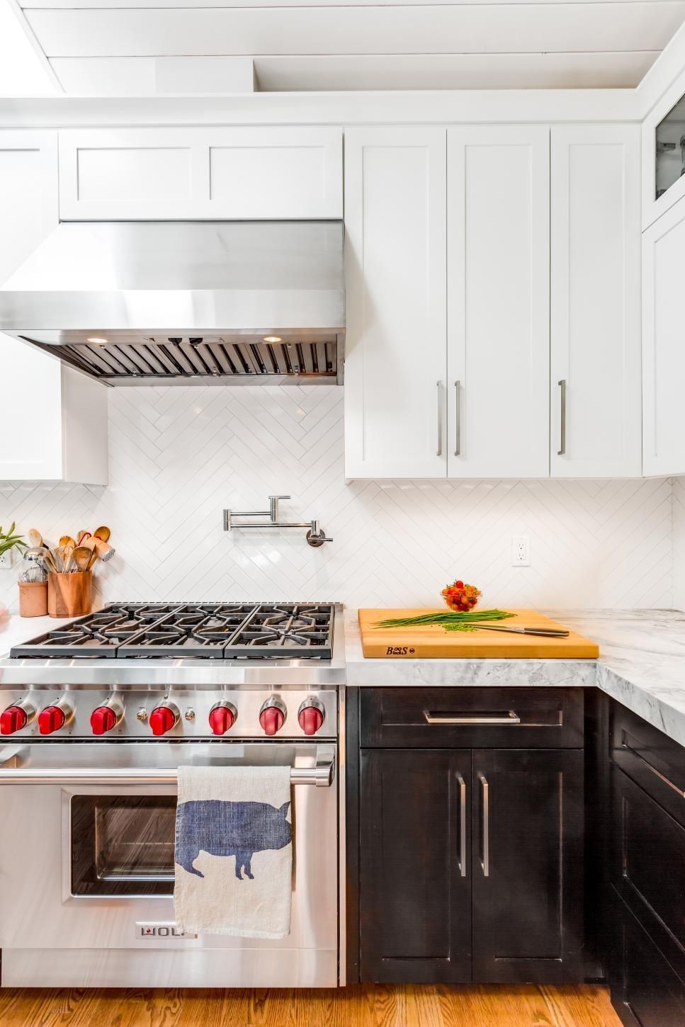 A stainless steel gas range makes cooking a breeze in this