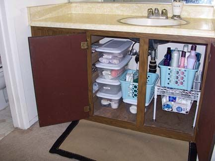 Tidy sink. Use baskets and Sterilite containers to organize under your sink!  - Tidy. Under Cabinet Storage Ideas ... - Under Cabinet Storage Ideas IDI Design