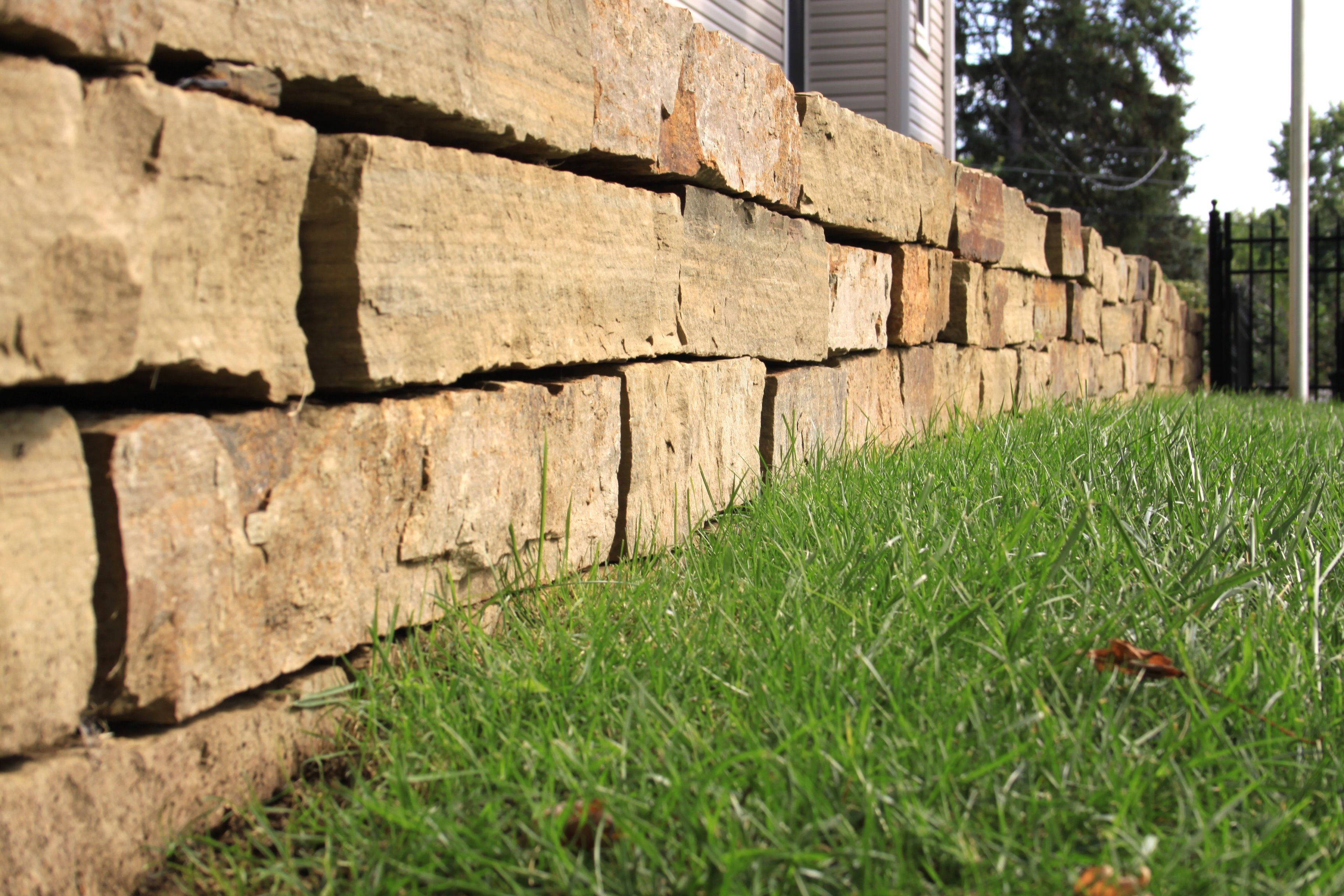 Natural stone retaining wall dividing properties. | Natural Stone ...