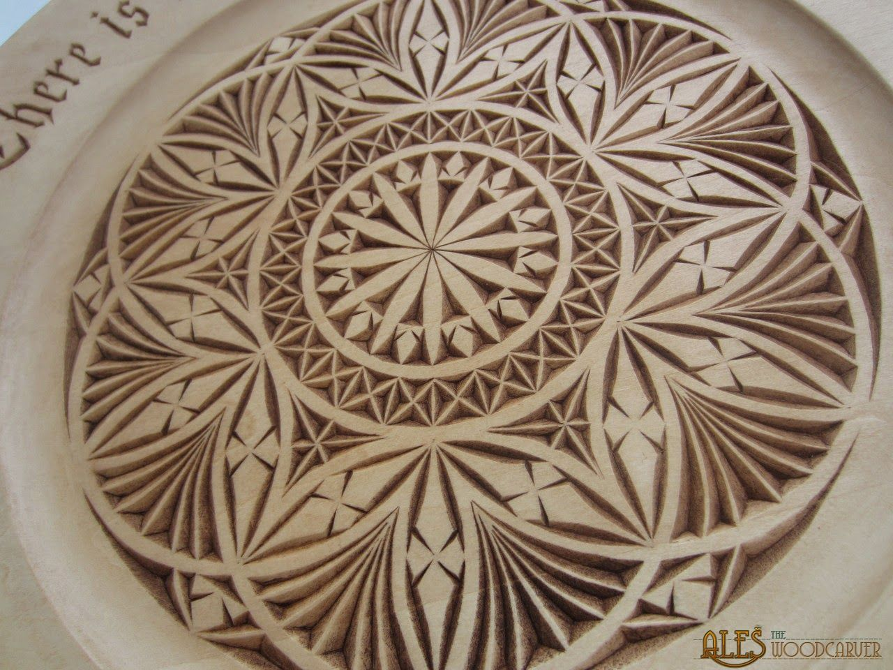 Detail of basswood plate chip carving by ales janosik