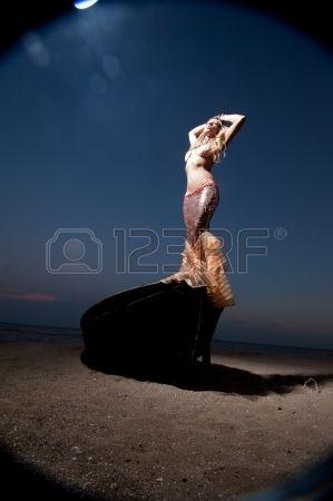 http://us.123rf.com/450wm/fotoluxstudio/fotoluxstudio1301/fotoluxstudio130100253/17669753-mermaid-girl-stands-on-an-old-boat-on-the-shore.jp...