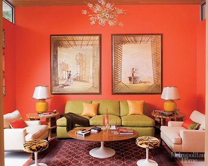 A Triadic Color Scheme Is Used In The Space By Eye Attracting Red Orange Walls Restful Yellow Green Sofa And Decorative Blue Violet Rug