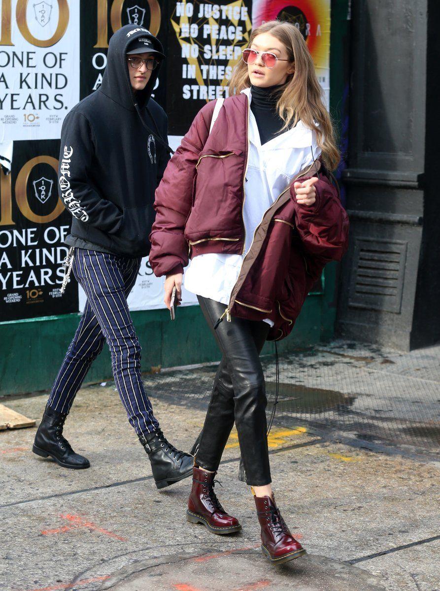 Gigi Hadid street style - burgundy bomber jacket, crisp white button up, leather leggings, and burgundy Dr. Martens