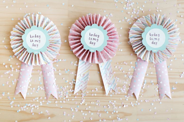 Paper rosettes are the perfect take-home gift for guests. Learn how to make your own on the blog. #celebratetoday #party #styling