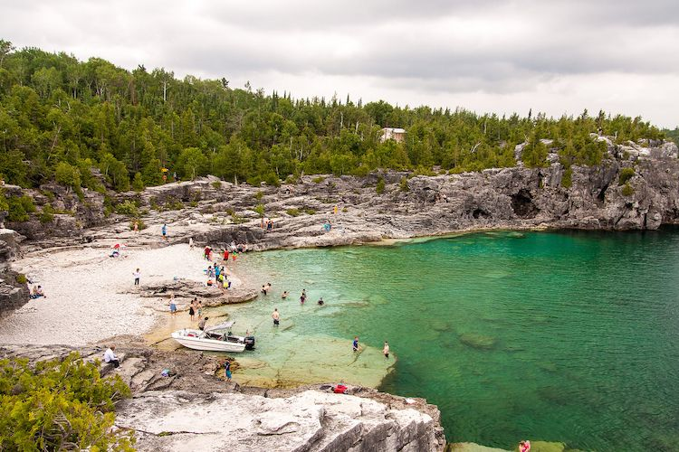 BRUCE PENINSULA NATIONAL PARK • Tobermory, Ontario | Inside the Bruce Peninsula National Park you'll find the crystal waters of the Grotto, a wide-mouth cave where teens and tourists frolick in summer (get to it by hiking along the rugged Georgian Bay Trail). Camping in the park runs year round — great for rugged types who don't mind pitching a tent in minus temps. | Photo, Flickr/Conrad Kuiper
