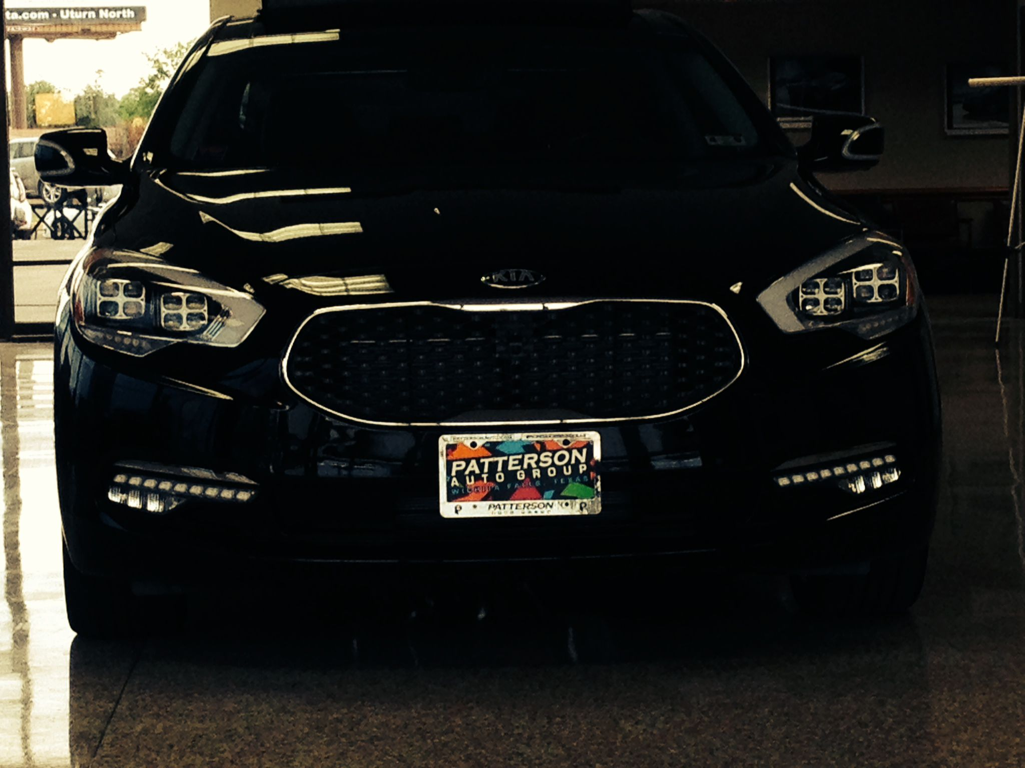 Clean front view of the headlights and grille on the new kia k900
