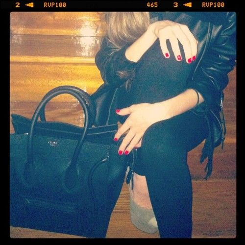 Black Celine luggage tote + red hot nails.