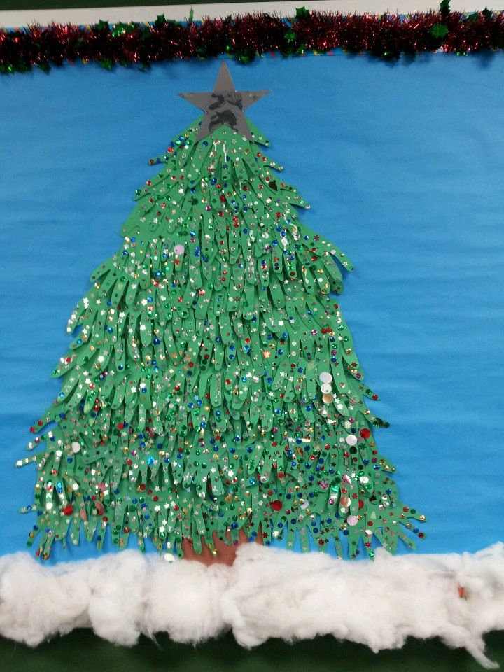 this is a bulletin board tree made from construction paper with loads of glitter