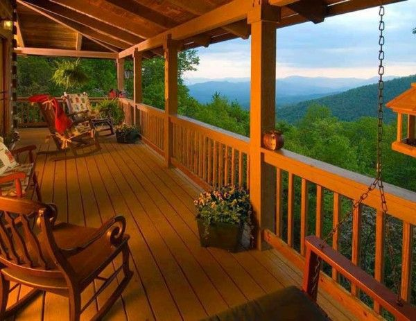 Log Cabin Front Porch Ideas With Vintage Rocking Chair Beside Hanging  Wooden Swing Bench Toward Plastic