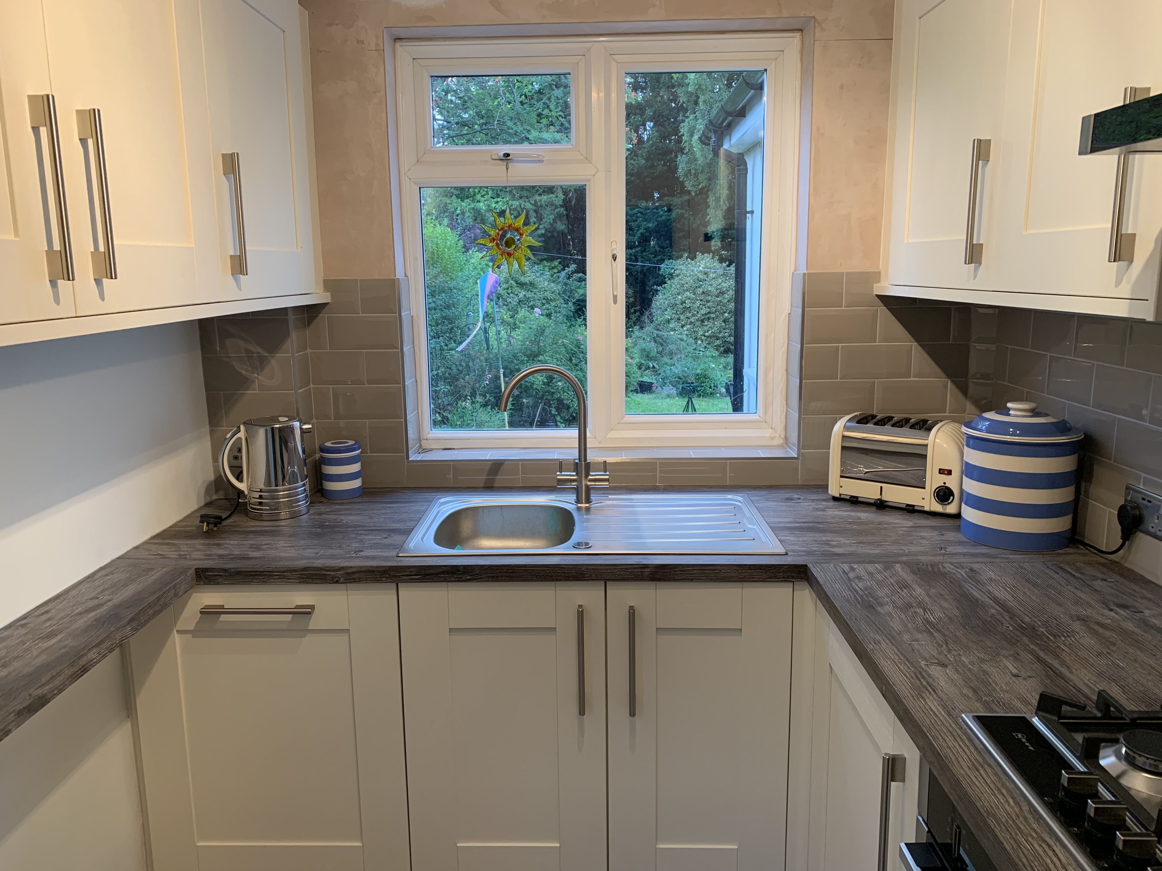 Wickes Milton Bone shaker kitchen with mystic pine worktop