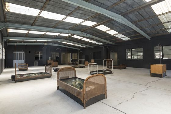 CHEN ZHEN, Jardin Lavoir, 2000, Water, system of showers (waterwork), beds, metal, glass, Found objects; about 700 x 2000 x 1800 cm. Galleria Continua Les Moulins 2015. Photo by Oak Taylor-Smith.