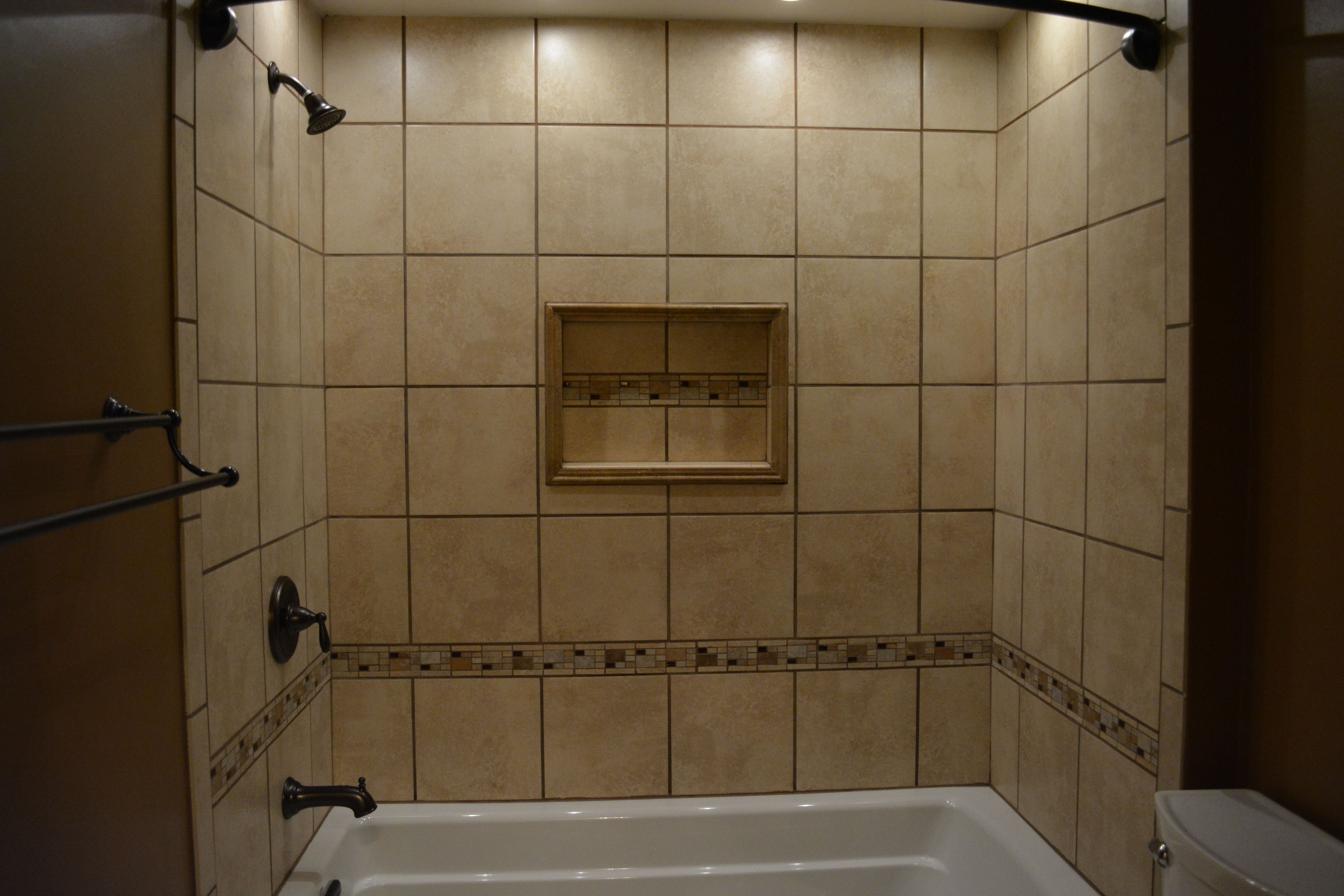 Ceramic Tile Tub Surround With Niche And Mosaic Accents 66 Kohler Soaking Moen Rubbed Bronze Faucets