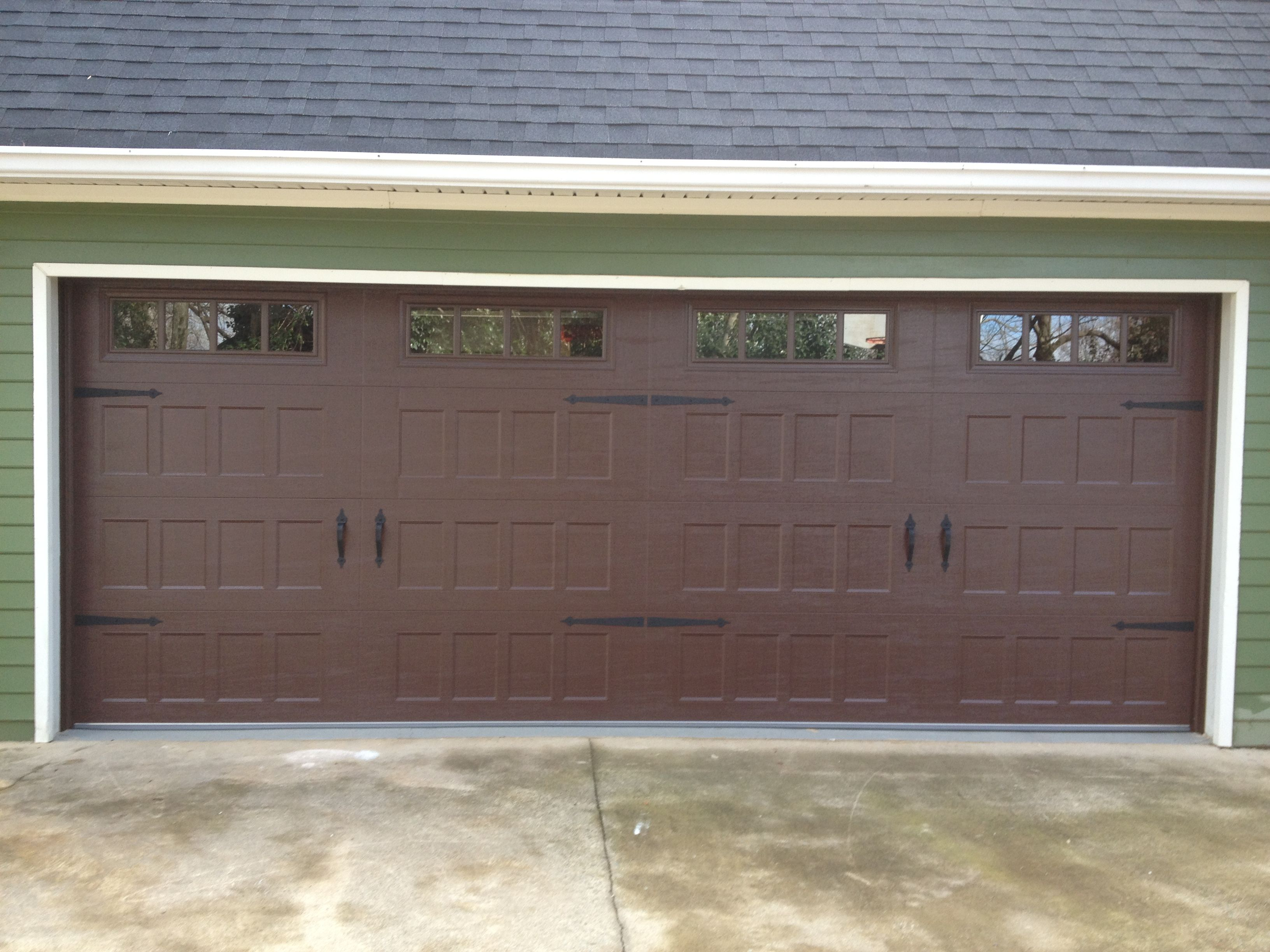 steel raised panel carriage house garage door with windows and