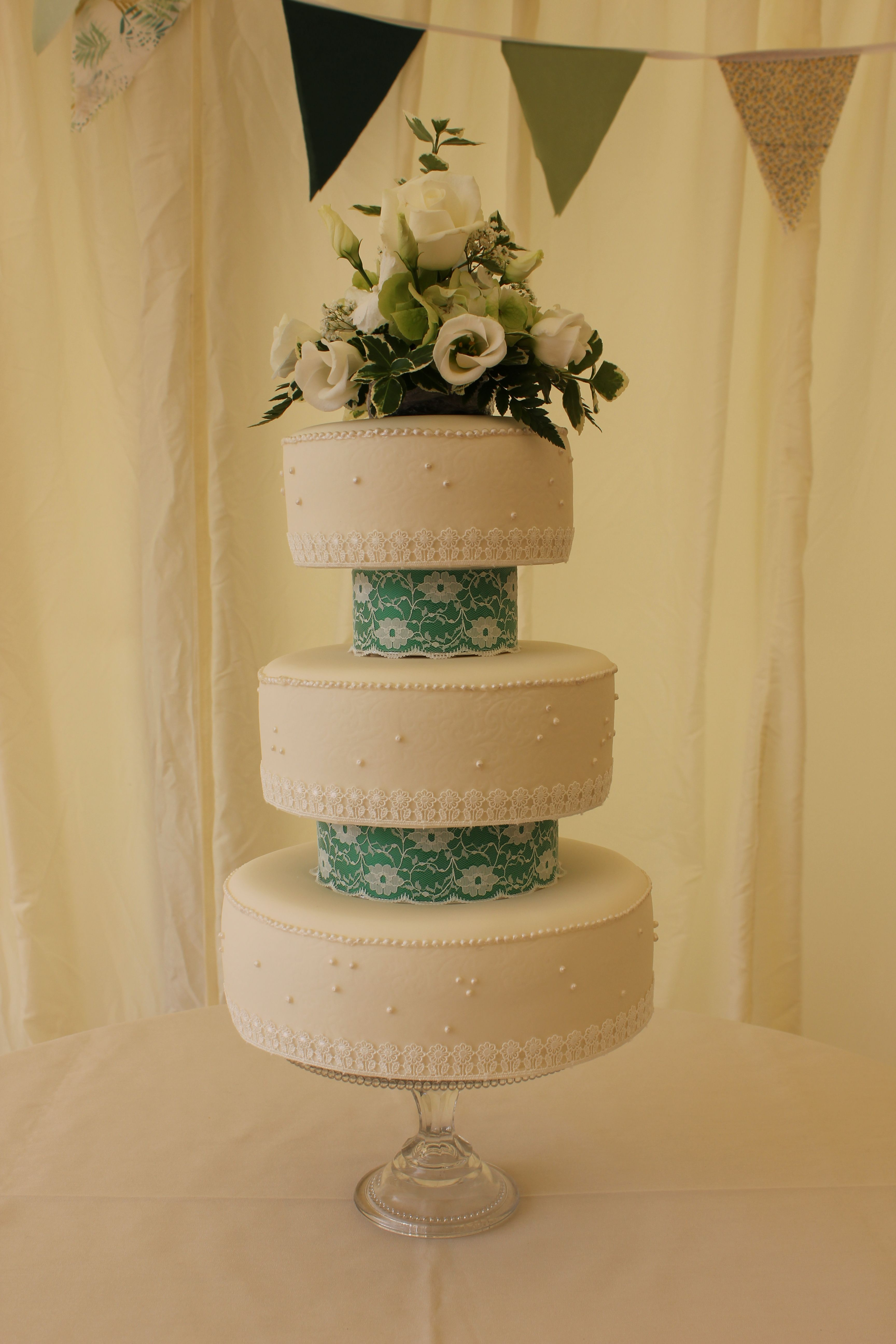 Claire: Ivory Wedding Cake with Embossed Lace Patter and Hand-piped ...