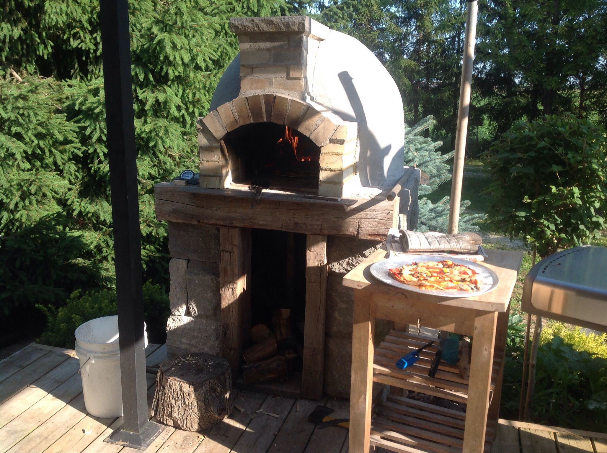 Out door wood fired pizza oven built off the deck for the home