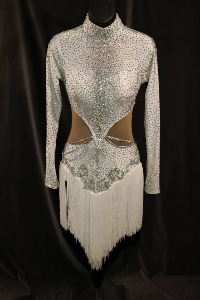 White fringe latin ballroom dress covered in lots of stones. White fringe skirt with black fringe underneath cut into V shape in front and back. Long sleeves, high neck, open back and side cutouts with nude fabric. Size adult medium/large. $750 USD or best offer.