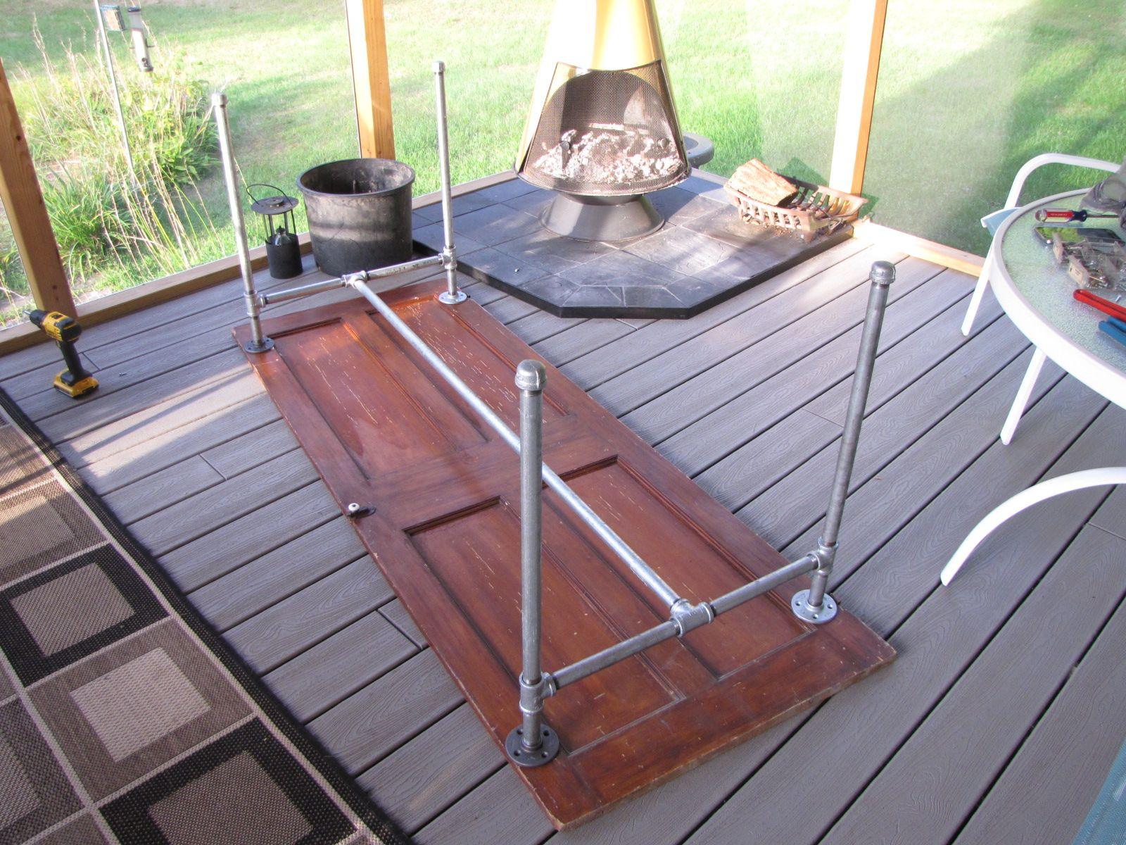 How We Took An Old Door And Galvanized Pipe To Make A Totally Awesome Table.