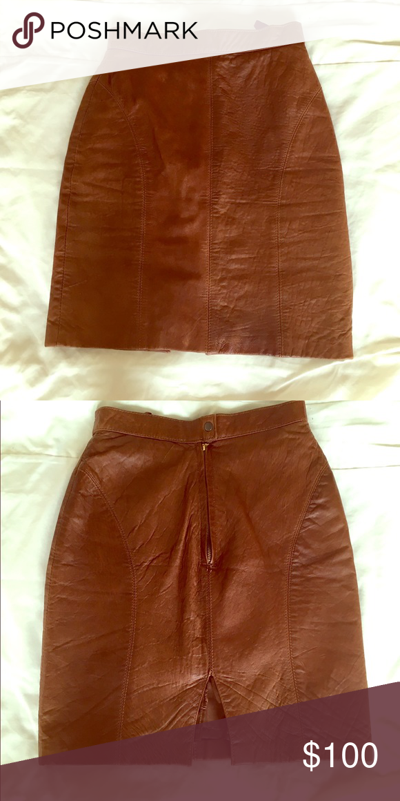 Genuine leather skirt Cognac colored genuine leather skirt mid waist bought from Italy fits a size 24-25 label says European 34 never worn Skirts Midi