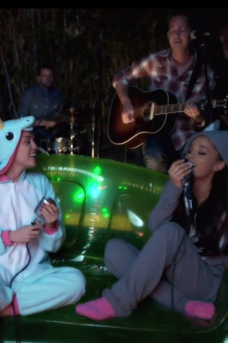 Miley Cyrus Ariana Grande Team Up For Flirty Backyard Singing