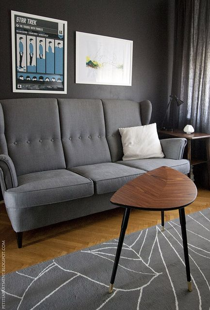 Mid century modern living room with grey strandmon sofa for Dark grey couch