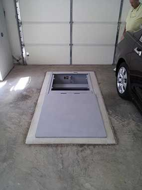 Underground storm shelters georgia mississippi tennessee for Garage safe room