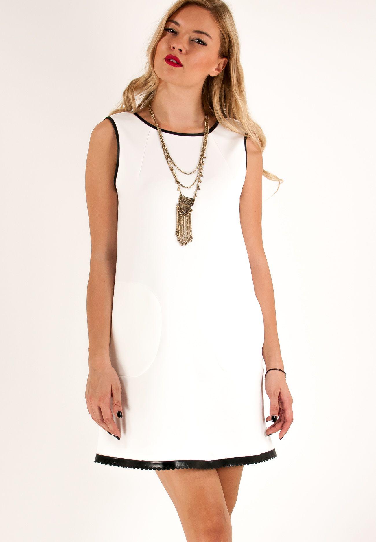3977eda5246 Μίνι αμάνικο φόρεμα σε ίσια γραμμή με τσέπες στα πλάγια και δερμάτινη  λεπτομέρεια στο στρίφωμα.