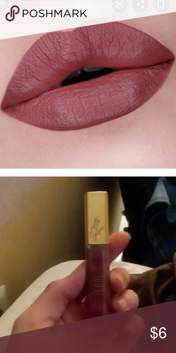 Milani - classic This is a pretty red muave shade called classic by the amore stain matte lip cream collection by milani. The formula is very light weight and stays on forever with amazing pigment brand new Milani Makeup Lipstick