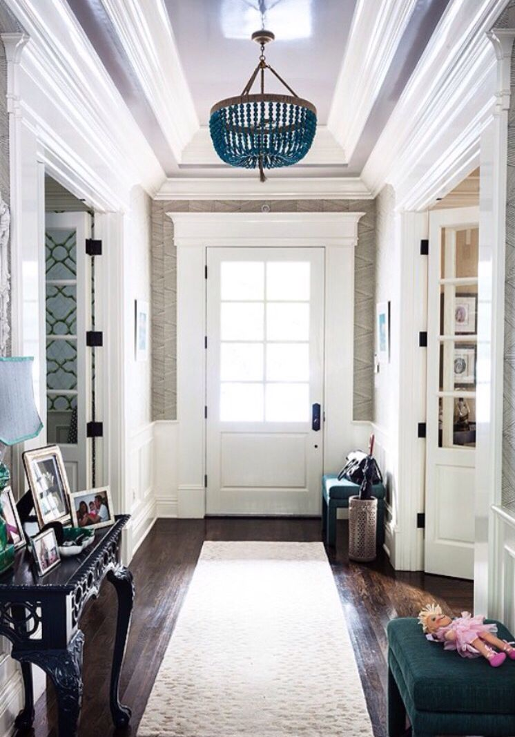 Grasscloth foyer with glossy ceiling