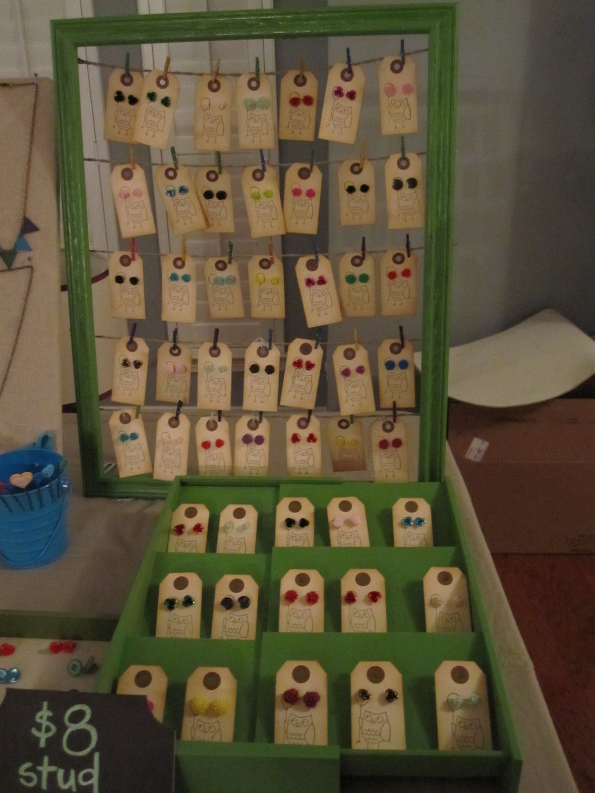 Earring Card Display Made From Picture Frame And Twine; Mini Clothespins  Hold Earring Cards In