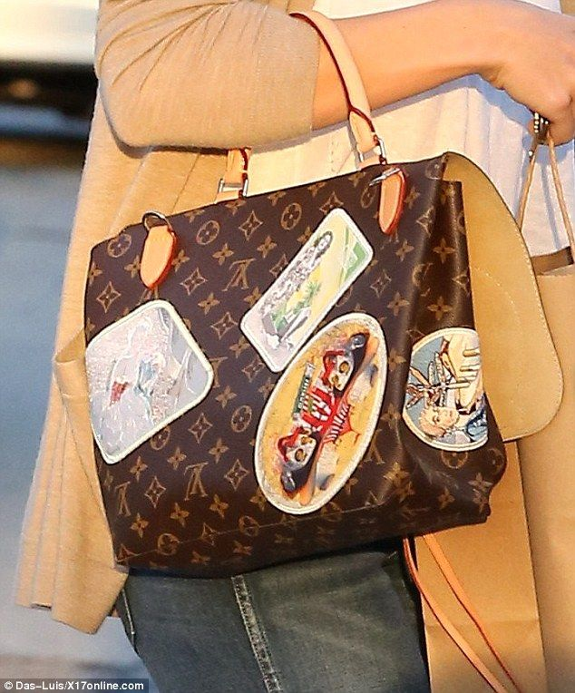 297b81c7eabc Attention-grabbing accessory  The Louis Vuitton Cindy Sherman camera  messenger bag is a limited edition featuring multicolor embroidered patches  based on ...
