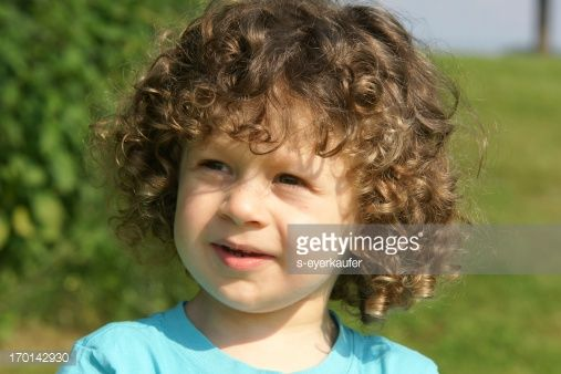 Cute little boy with curly hair outdoors stock photo getty cute little boy with curly hair outdoors stock photo getty images publicscrutiny Choice Image