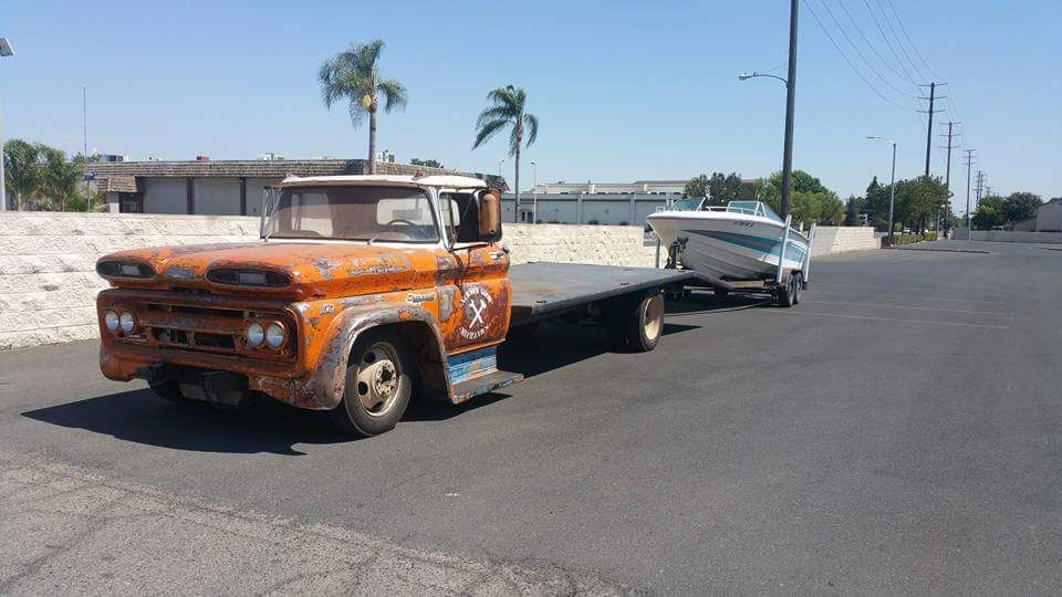 1960 63 Chevy C30 Car Hauler With Custom Flatbed Pulling A Boat