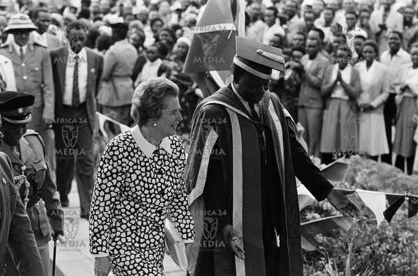British Prime Minister Margaret Thatcher walks up the dias with President Daniel arap Moi at the Moi University campus in Eldoret during a graduation ceremony held on 6th January 1988