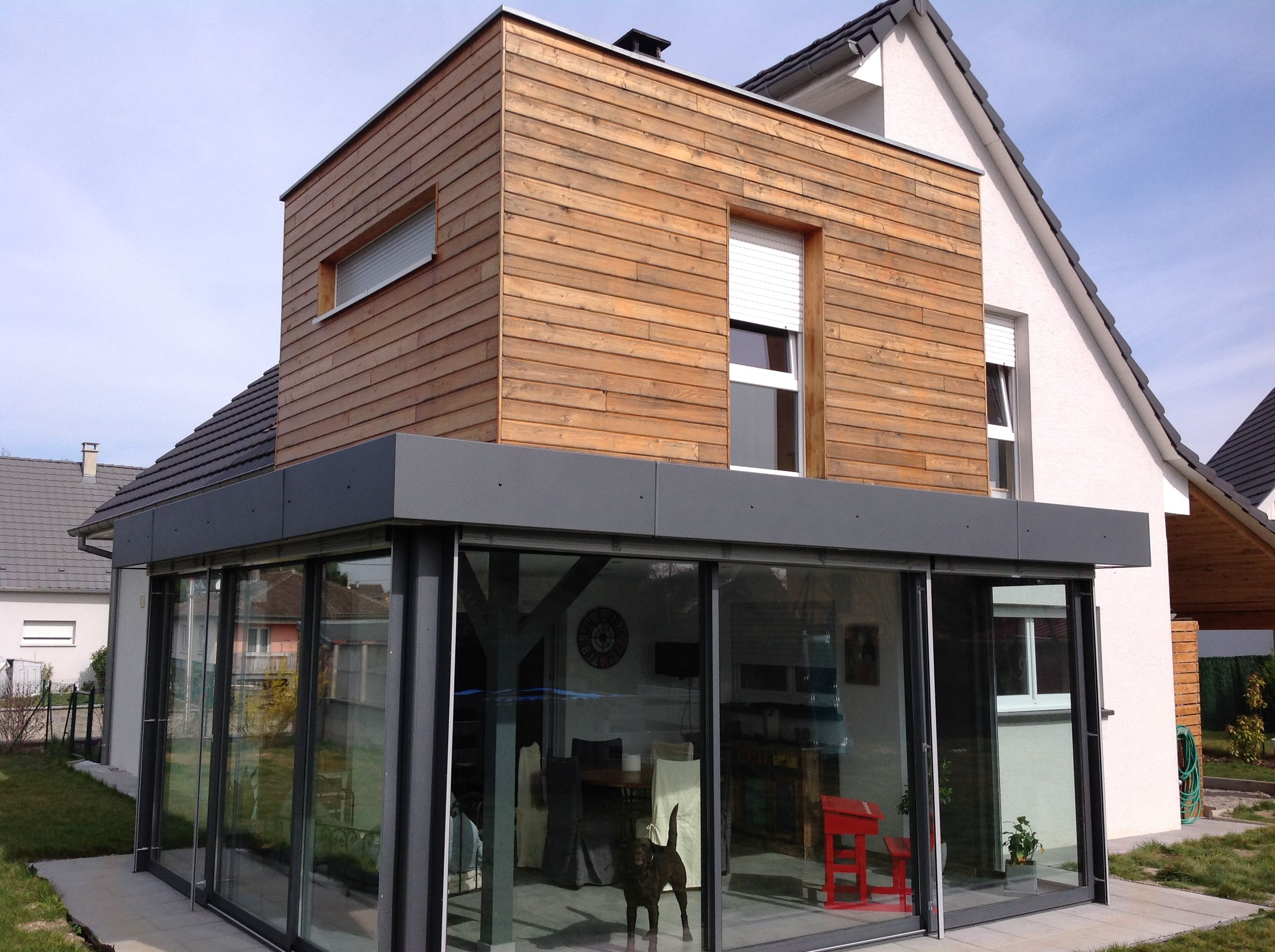 Extension terrasse avec tage en ossature bois veranda for Extension maison 56