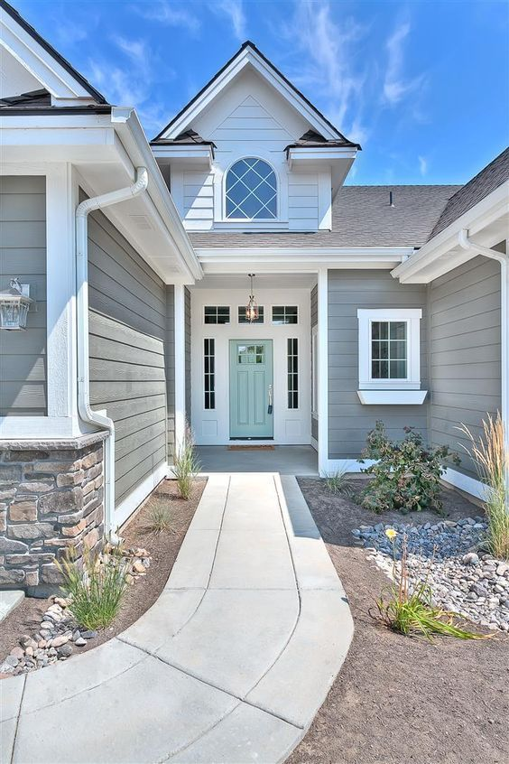 Exterior Paint Colors that Increase Curb Appeal | Exterior color is Amherst Gray Benjamin Moore and Door Color is Wythe Blue Benjamin Moore | More info on Remodelaholic.com #greyexteriorhousecolors