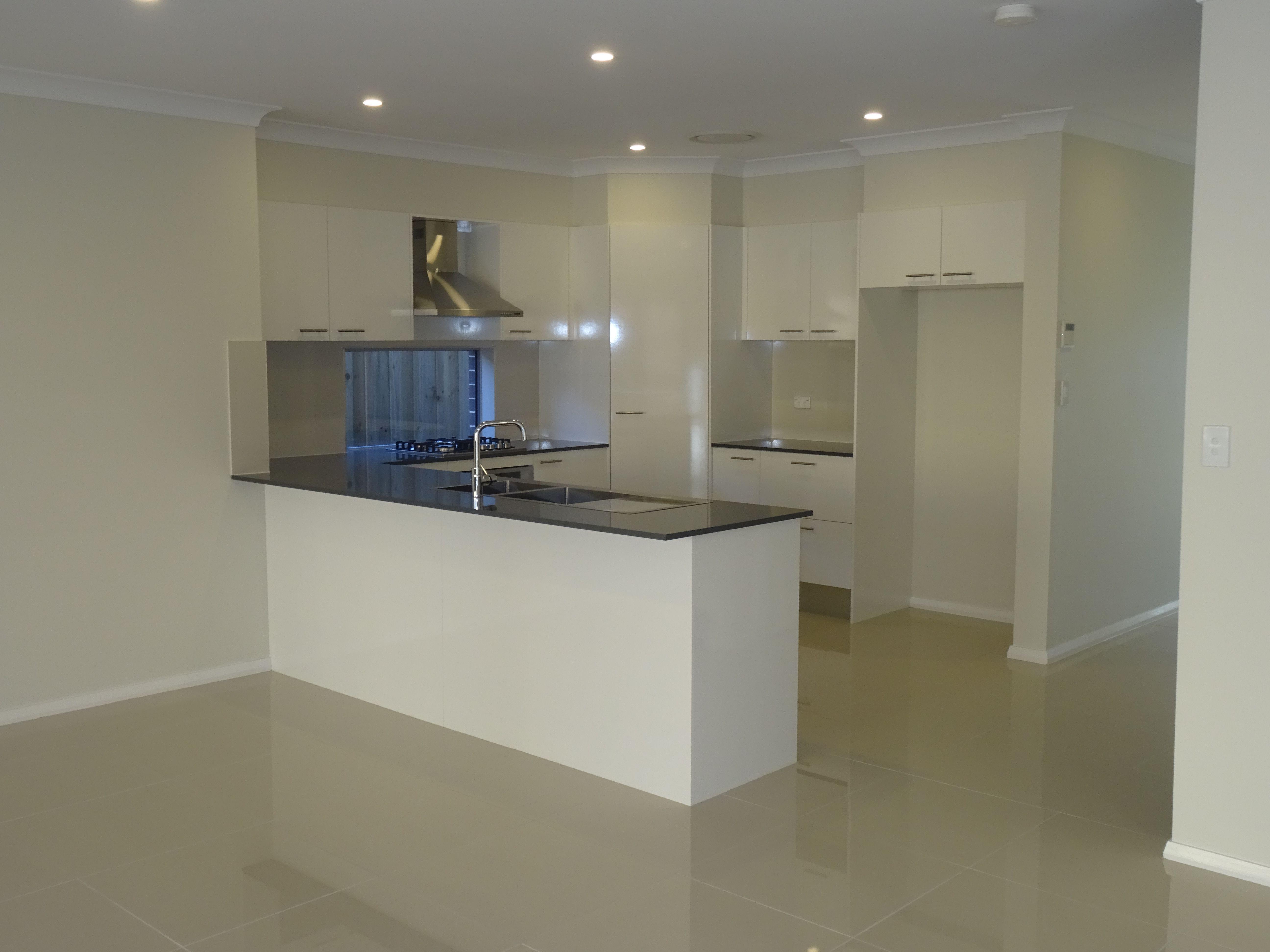 design your kitchen design your kitchen Formica Snowdrift gloss cabnitry Essastone 20mm Benchtop in Carbon mm Baumatic Appliances Design Your KitchenAppliances