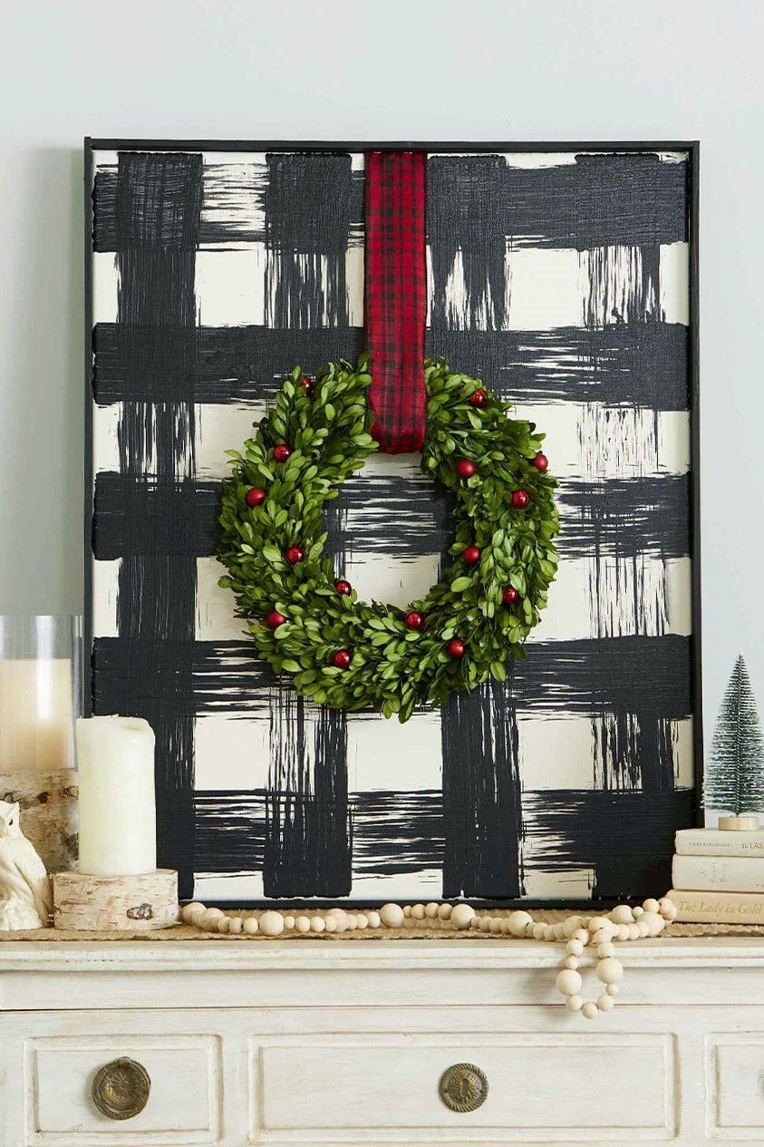 Add a touch of farmhouse style to your Christmas decor with this oversize DIY buffalo check art. #buffalocheckdecor #christmasdecor #buffalocheckchristmas #farmhouse #ginghamdecor #bhg