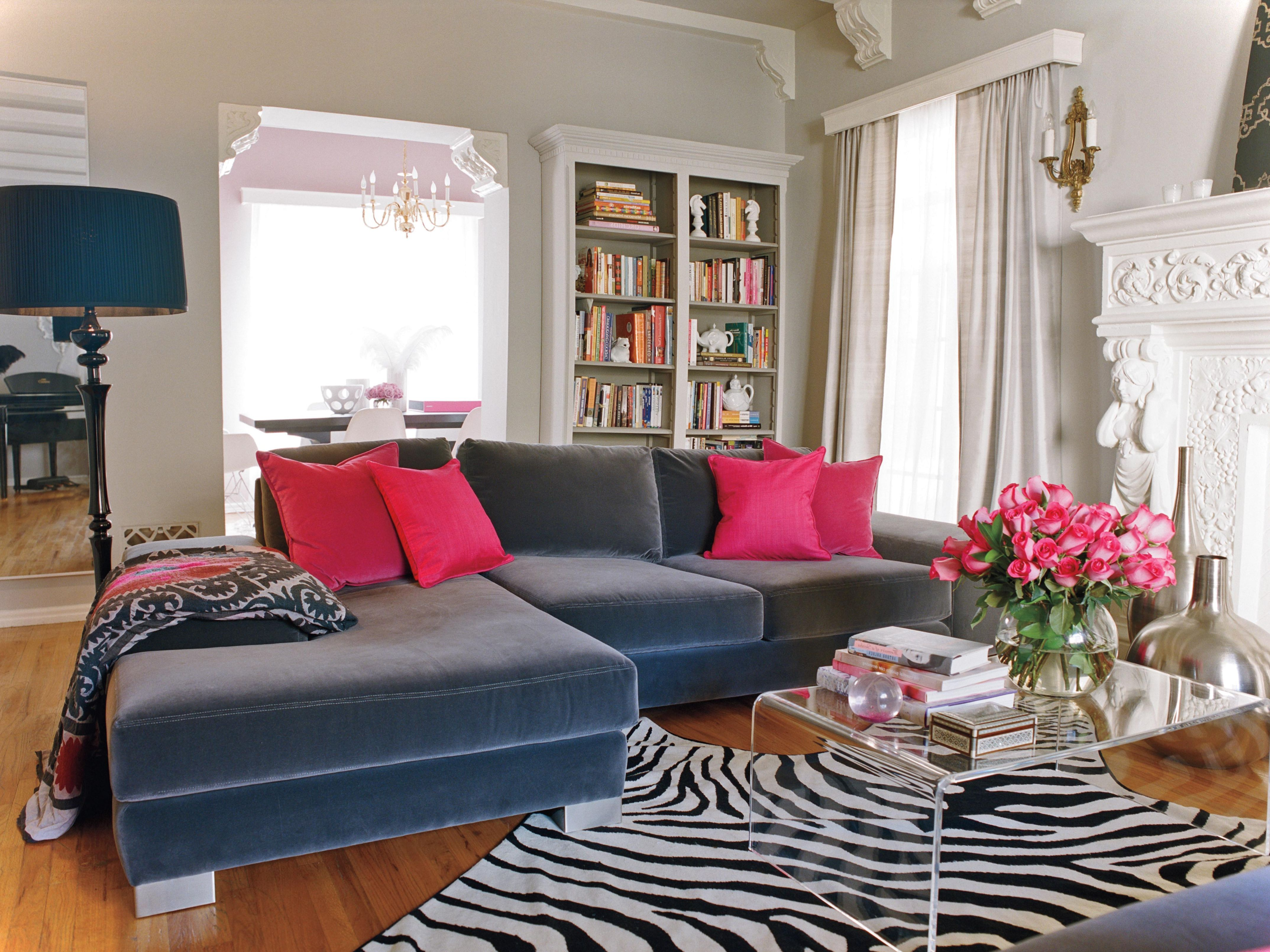 zebra rug and hot pink pillows  romantic living room