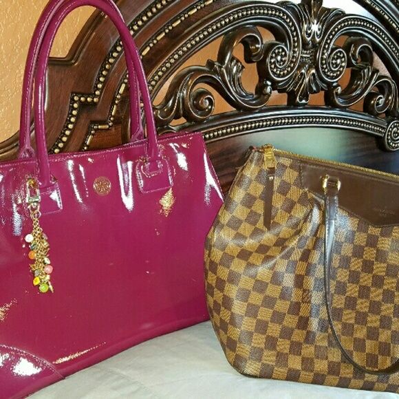 Tory  Burch Xl.... shown  next to my Westminster  GM. This is a huge bag. Very selective  trades.  ( charm not included ) Tory Burch Bags