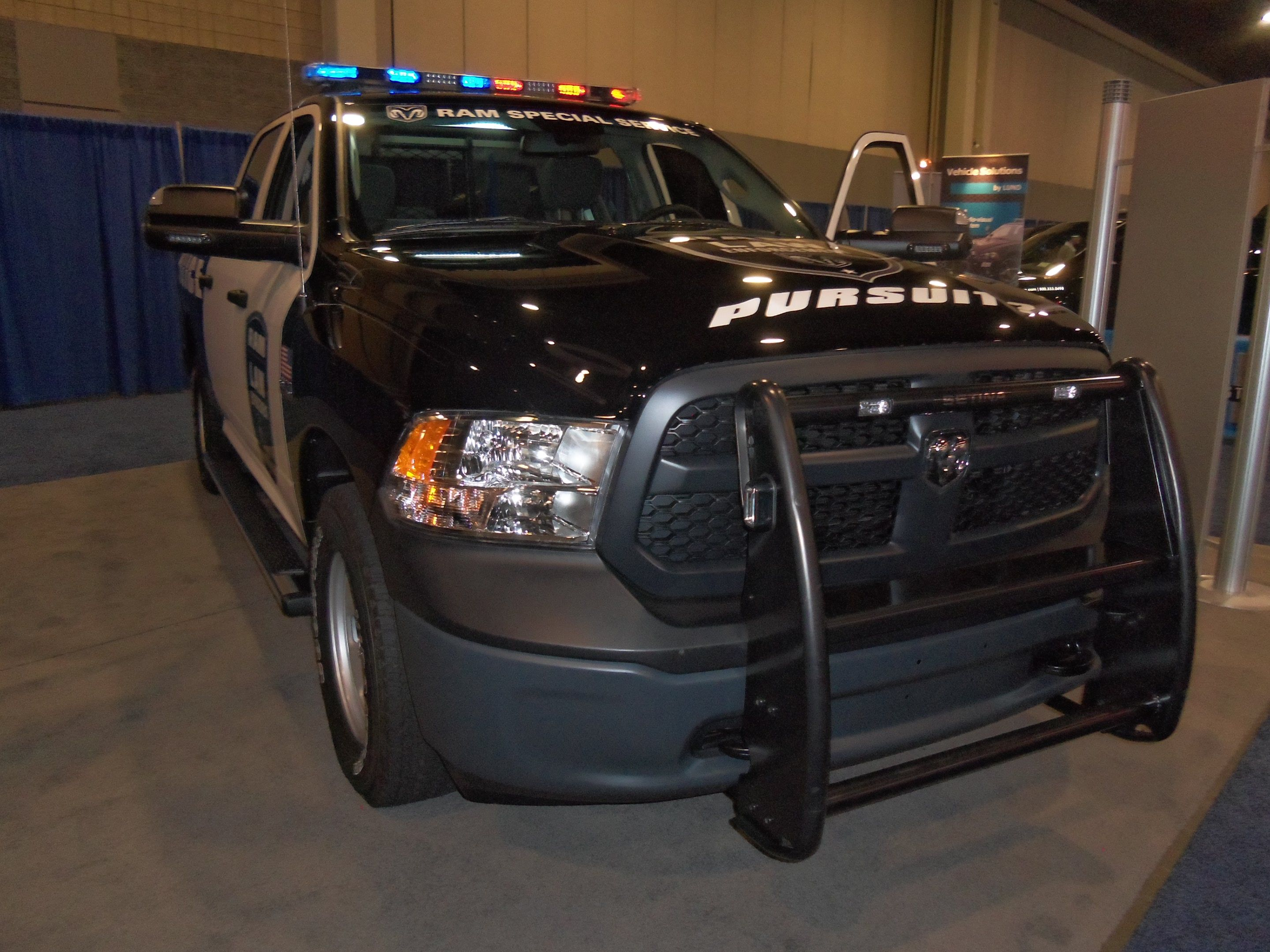 The dodge ram 1500 special service vehicle displayed in chrysler s booth at 2013 police fleet expo