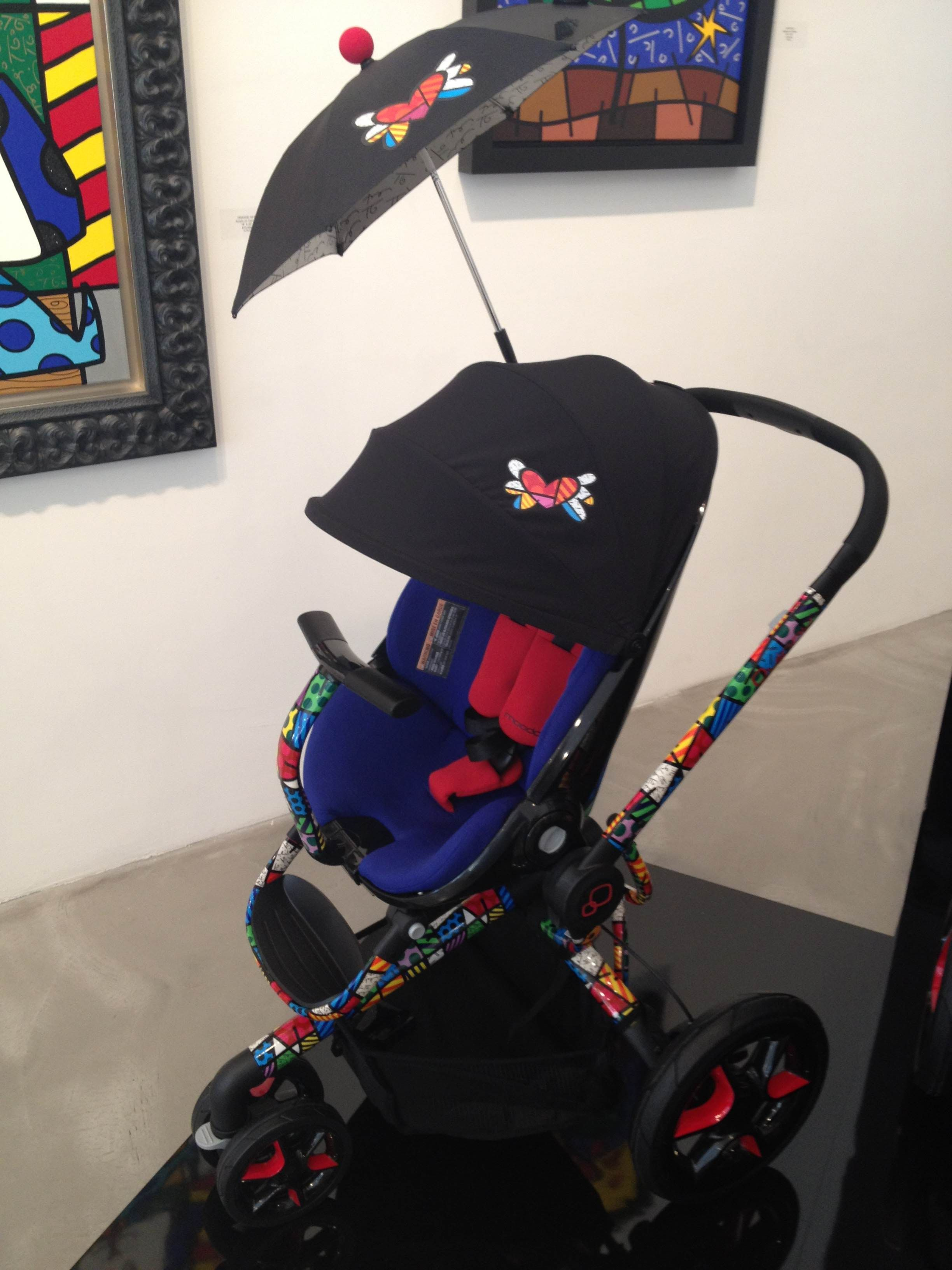 fab7f8d8d2b Quinny by Britto Moodd in Blue with the Britto Heart parasol.  Quinny   MaxiCosi