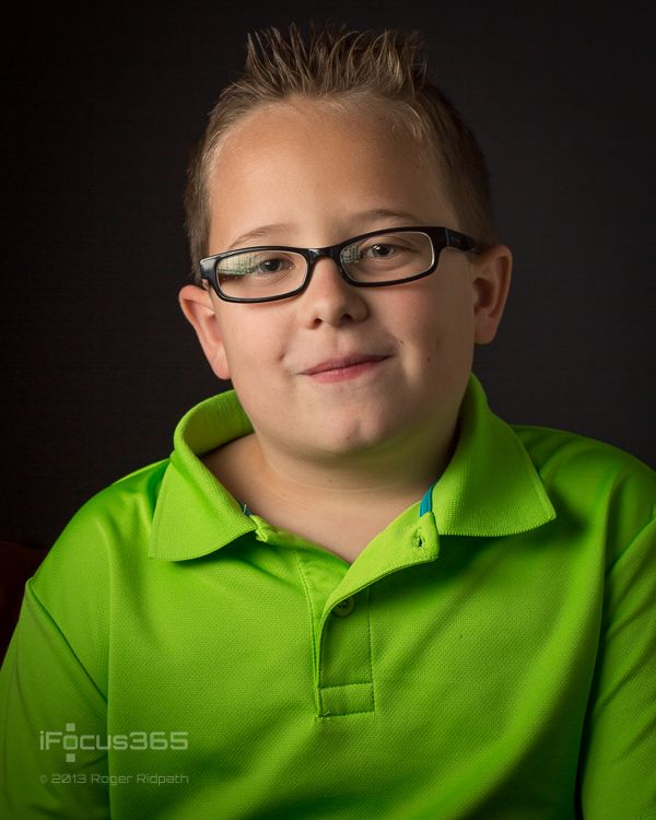 young boy with glasses portrait