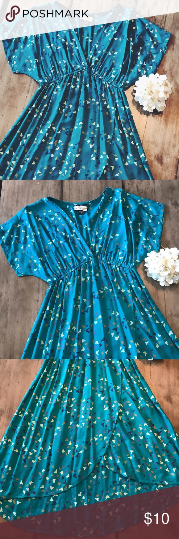 👗 Angie Bird Printed V-Neck Dress 👗 👗🐦 Gently used Angie bird printed v-neck dress-- juniors size large-- teal dress with navy/purple/gold/white/cream birds-- dry-cleaned-- minor pilling (see last picture)-- 100% rayon 👗🐦 Angie Dresses