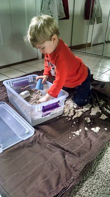 Much needed activity to help a tired boy let momma get some work done! One of our favorites! Great heavy work and tactile activity to help improve regulation. I will be doing an experiment this summer to make our own to see how well it holds! #kineticsand http://littletikestherapy.com/kineticsand (affiliate link)