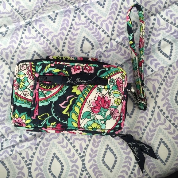 Vera Bradley Wristlet Brand new without tags never used!! Such a cute wallet, I just have a different one that I use. Completely functional without any scuffs or stains. Perfect mint condition!! Roomy and great. Price is negotiable, I'm very flexible, just want to sell this! Vera Bradley Bags Clutches & Wristlets