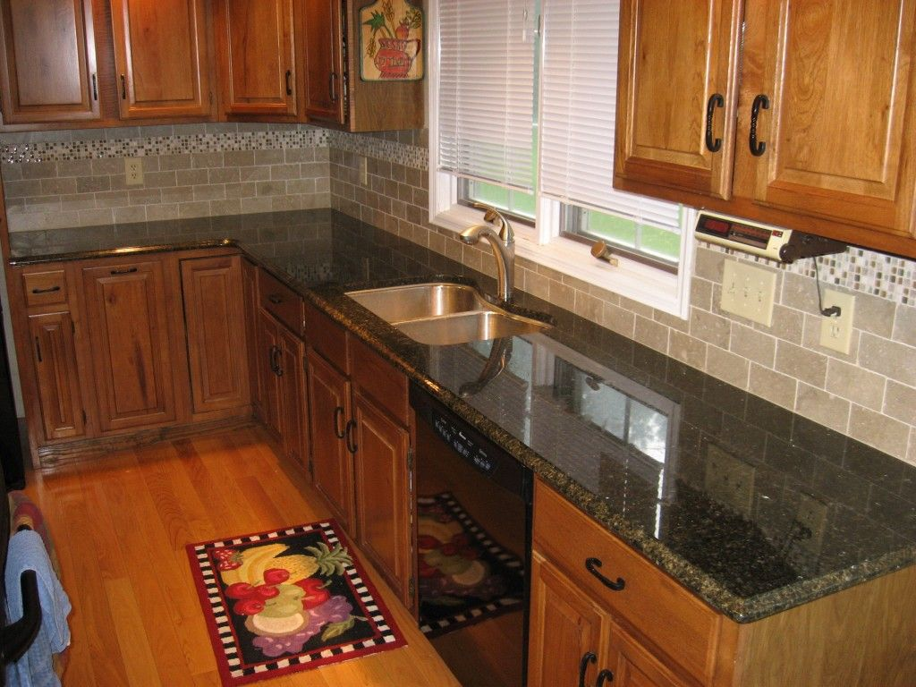 Kitchen Backsplash Cherry Cabinets White Counter new kitchen backsplash with tumbled limestone subway tile and