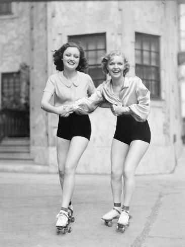 Photo: Two Young Women with Roller Blades Skating on the Road and Smiling : 24x18in