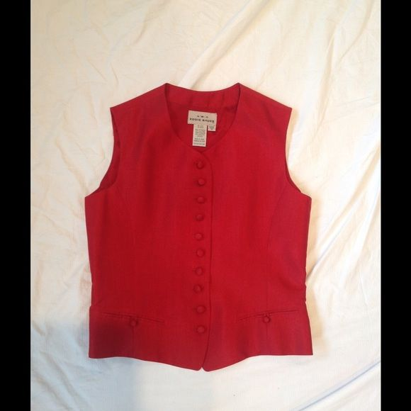 Lined silk 10 button vest. Lovely tailoring.  Double welt front pockets, adjustment in back for fit.  Only worn once, but back shows some fading of rich red from storage (see pic). (Front is perfect.) AKA Tops